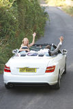 Bride And Groom Driving Away In Decorated Car Stock Photos