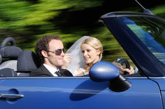 Bride and groom driving to their bright future stock photography