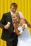 The bride and groom eat ice cream Royalty Free Stock Photos