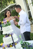 Bride and groom eating cake. Shot of a bride and groom eating cake royalty free stock photography