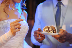 Bride and groom eating cake Stock Image