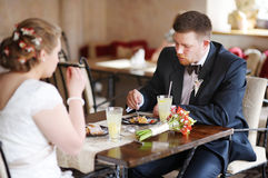 Bride and groom eating a dessert Stock Photos