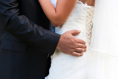 Bride and groom embrace each other Royalty Free Stock Photos