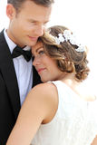 Bride and groom embrace each other Stock Photo