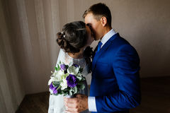 The bride and groom embrace and kiss. Bride and groom kissing. Couple in love at wedding day Royalty Free Stock Photography