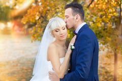 Bride and groom embrace on a walk in the countryside for a walk Royalty Free Stock Image