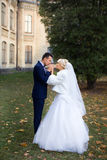Bride and groom embrace on a walk in the countryside for a walk Stock Photo