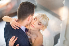 Bride and groom embrace on a walk in the countryside for a walk Royalty Free Stock Photography