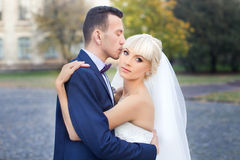 Bride and groom embrace on a walk in the countryside for a walk Royalty Free Stock Photo