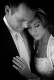 Bride and Groom Embracing. Bride and Groom-Black and White Royalty Free Stock Image