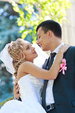 Bride and groom embracing Stock Image
