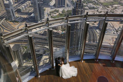Bride and groom embracing above Dubai cityscape Royalty Free Stock Image