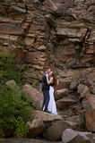 Bride and groom embracing against the backdrop of the mountains Stock Image