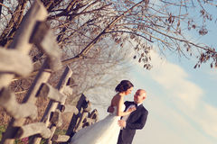 Bride and groom embracing Stock Images
