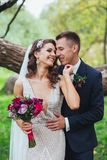Bride and groom embracing in the park. Wedding Stock Photo