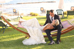 Bride and groom embracing in a tropical resort Stock Image