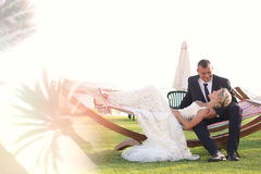Bride and groom embracing in a tropical resort Royalty Free Stock Images