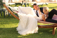 Bride and groom embracing in a tropical resort Royalty Free Stock Photography