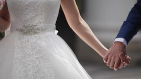 Bride and groom embracing and walking on a street stock footage