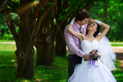 Bride and groom embracing Royalty Free Stock Photo