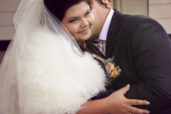 Bride and groom embracing. Young happy couple embracing and kissing close-up Stock Photography