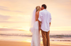 Bride and Groom, Enjoying Amazing Sunset on a Beautiful Tropical Royalty Free Stock Images