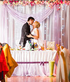 Bride And Groom Enjoying Meal At Wedding Reception stock images
