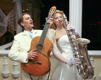 The bride and groom are entertained guests at a party in honor o Stock Photography