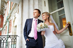 Bride and groom at entrance to palace in Moscow Royalty Free Stock Photography