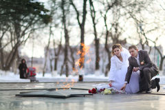 Bride and groom at the eternal flame Stock Photos