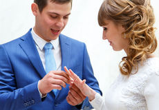 Bride and groom exchange wedding rings at ceremony in wedding Stock Photo