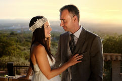 Bride and groom eye contact at sunset. At a viewpoint royalty free stock photos