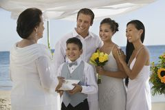 Bride and Groom with family at beach wedding Royalty Free Stock Images