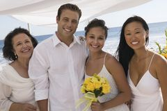 Bride and groom with family at beach wedding (portrait) Stock Photos