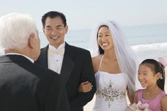 Bride and Groom with family by ocean stock photos