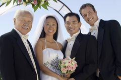Bride, Groom, father and best man royalty free stock photography