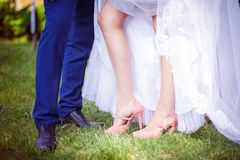 Bride and groom, feet, grass Royalty Free Stock Images