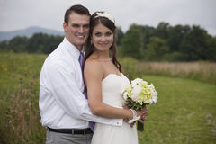 Bride and Groom in a Field Stock Images