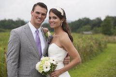 Bride and Groom in a Field Royalty Free Stock Photography