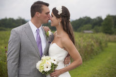 Bride and Groom in a Field Stock Photography
