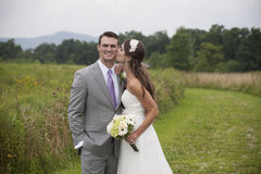 Bride and Groom in a Field Royalty Free Stock Image