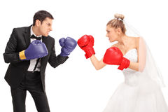 Bride and groom fighting each other Royalty Free Stock Photos