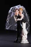Bride and groom figures as wedding invitation Stock Photo