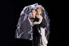 Bride and groom figures as wedding invitation Stock Images