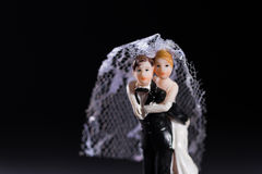 Bride and groom figures as wedding invitation Stock Photography