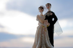 Bride and groom figurine. Photo of the bride and groom figurine with sky in background Royalty Free Stock Photo
