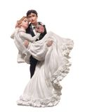 Bride and groom figurines. Isolated over white Stock Image