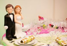 Bride and groom figurines on a table Stock Photo