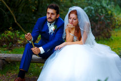 Bride and groom fishing together - romantic wedding concept. Stock Images