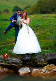 Bride and groom fishing together - romantic wedding concept. Stock Photos